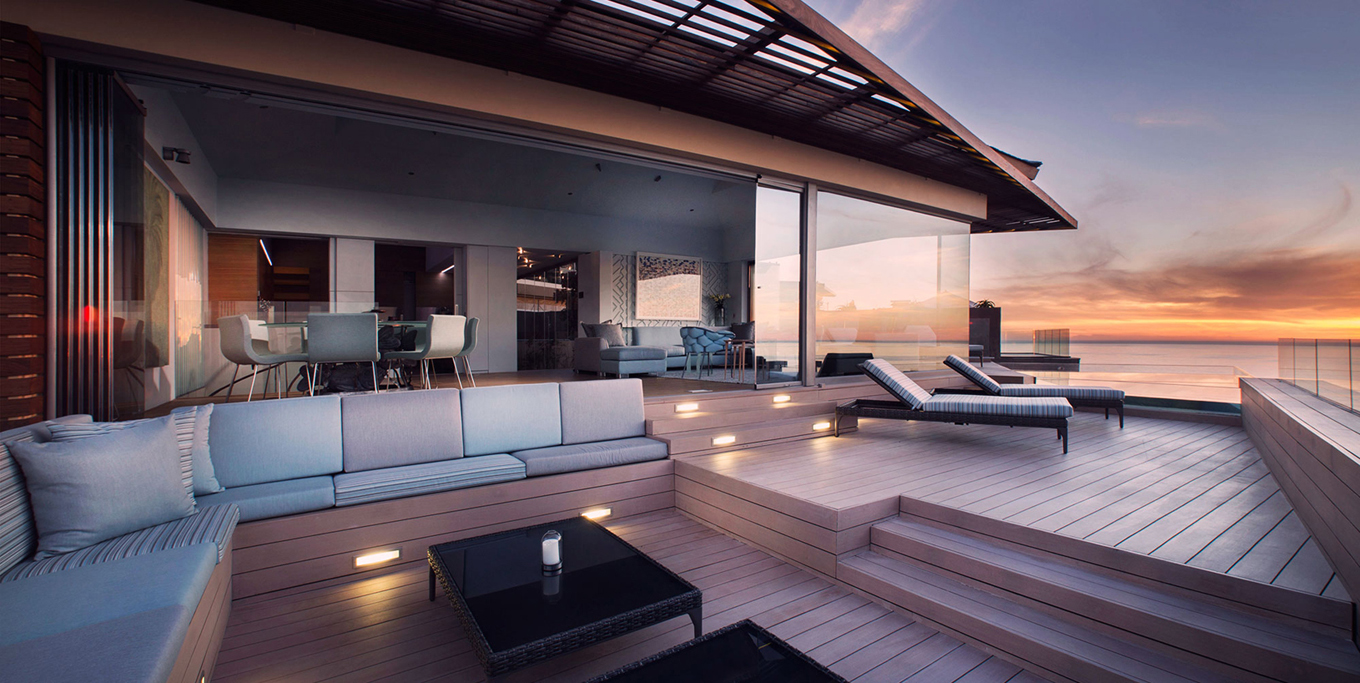 Deck-looks-over-the-ocean-and-sunset-at-Ellerman-Villa