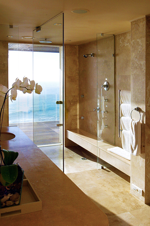 Travertine-bathroom-with-ocean-view-at-Ellerman-Villa-h