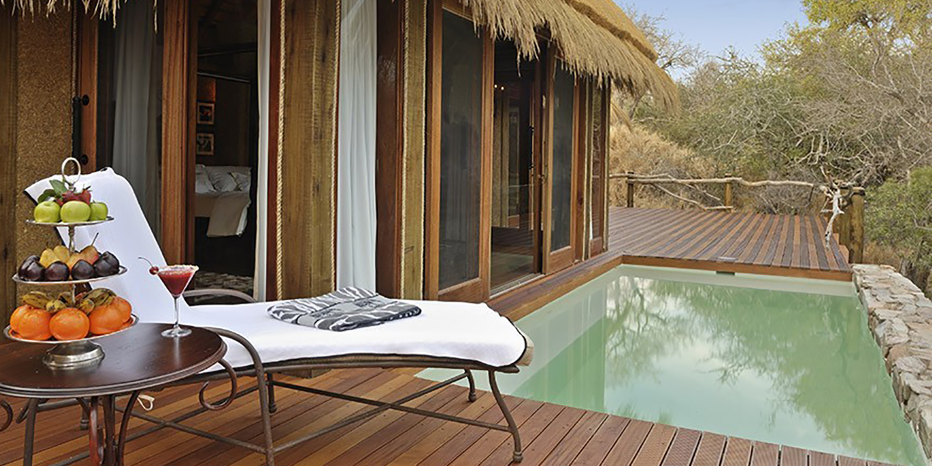 Zindoga Villa pool with view of the African bush
